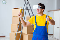 Painter contractor working with virtual reality goggles