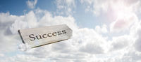 sign in front of a blue summer sky showing the way to Success Street concept with space for text