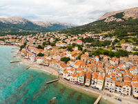 Aerial panoramic view of Baska town, popular touristic destination on island Krk, Croatia, Europe
