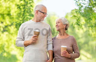 senior couple with coffee cups natural background