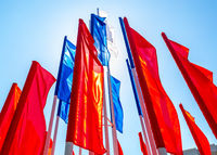 Colorful holiday flags fluttering against the sky