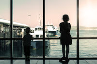 Brother and sister waiting for boat.