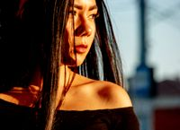 Asian Woman Looking At Sunset Outside In Profile Portrait In Vintage Color