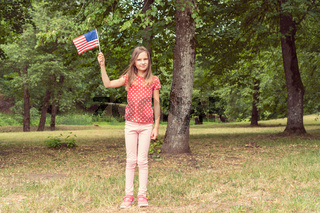 Girl with American flag for july 4th.
