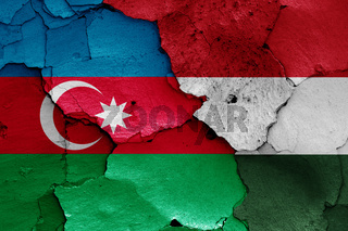 flags of Azerbaijani and Hungary painted on cracked wall