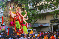 MUMBAI, INDIA, September 2017, People at Ganapati procession with huge Ganapati idols, carried on truck.