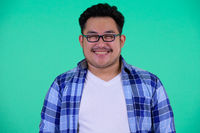 Face of happy young overweight Asian hipster man smiling
