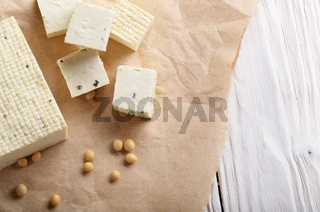 Soy Bean curd tofu on parchment paper Non-dairy alternative substitute for cheese
