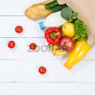 Einkauf Lebensmittel einkaufen Früchte Obst und Gemüse Quadrat Papiertüte von oben Holzbrett