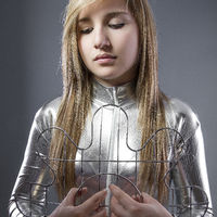 blond woman of the future with silver-plated suit, concept new technologies and adaptation of the human being