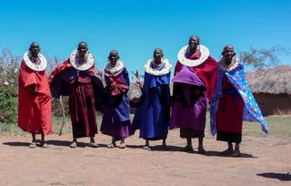 traditional Masai tribespeople in the savannah of Tanzania