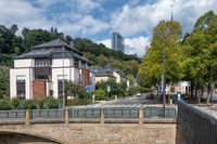 Luxembourg city along river Grund with European office building