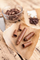 Delicious and sweet chocolate swirls on wooden background