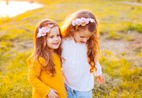 two sisters kids on sunset outdoor