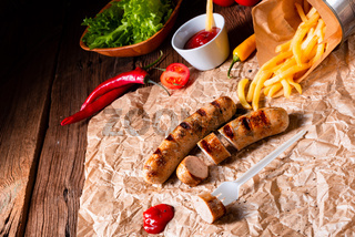 rustic bratwurst with pommes and hot ketchup