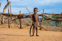 Hamer tribe kid playing with tire