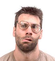 Goofy man with broken vintage glasses