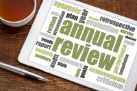 annual review word cloud on tablet