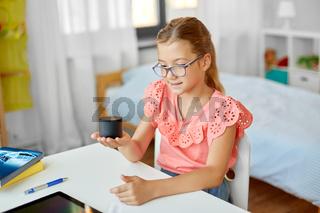 student girl using smart speaker at home