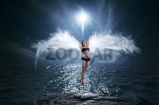 Concept dark art portrait of young woman with ethereal wings
