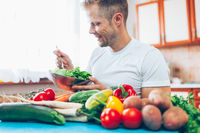 Young man at home on a healthy diet