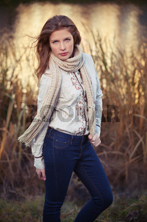 Young fashion girl in white shirt and scarf walking outdoor
