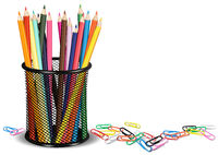 Pencils in a Pot and Paper Clips on White Ground
