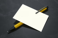 a pen and a white card
