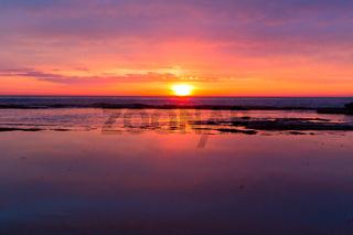 Coastal sunrises as daybreaks turning skies red, orange, pink and yellow