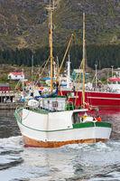 Fishing boat entering harbor in the Lofoten Islands in Norway