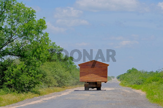 Prefab house moving on a truck and looking like a motorhome rv, Gran Chaco, Paraguay