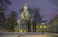 Snowfall and Smolny Convent with night illumination in St. Petersburg, Russia.