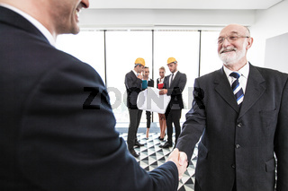 Architects and investors shaking hands