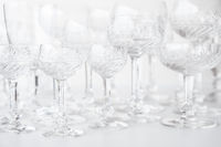 beautiful crystal glasses on white table, drinking glass