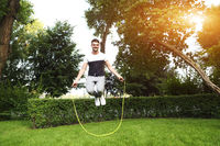 Young sporty man with jumping rope