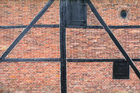 Brick wall of half-timbered house with wooden beams