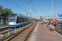 Passengers waiting at station Zeeburg for transportation to Amsterdam downtown