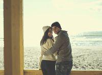 Couple chating and having fun at beach bar