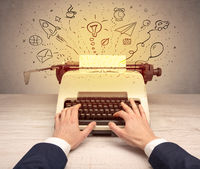 Vintage typewriter with doodles around