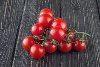 Two branches of cherry tomatoes