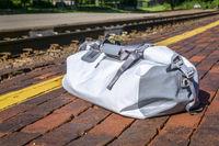 waterproof duffel at train station platform