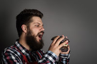 Man biting black hamburger