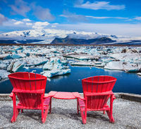 Two red deck chairs