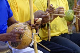 Some berimbau players during performance