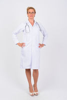 Full body shot of happy mature woman doctor smiling
