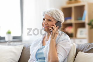 senior woman calling on smartphone at home