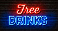 Neon sign on a brick wall - Free Drinks