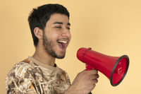 Young Man shouting in speaker
