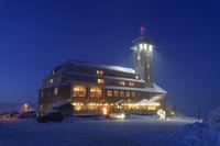 Fichtelberghaus on the summit of Fichtelberg at dusk in winter
