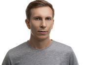 Resolute man in gray t-shirt isolated portrait